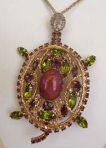 This is a pendant my grandmother left in her jewelry box when she died. I gave it to my mom as a gag gift at Christmas. I just saw on Ebay it sold for $85 in July. I want it back now.