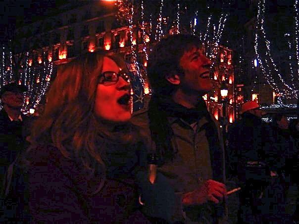 """screaming """"BONNE ANNÉE"""" on the Avenue des Champs-Élysées, champagne in hand"""